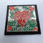 'Yule Love.' Red ceramic heart with holly berries and green leaves with mirrored background